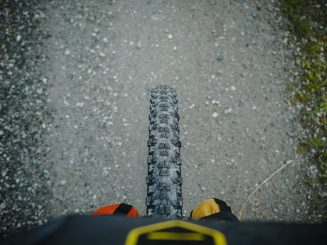 Bicycle tyre, gravel road background