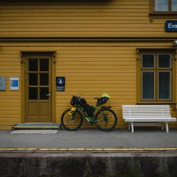 Packed touring bike at a train station