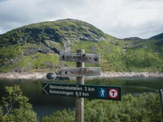 signpost for hikers, reservoir in the background