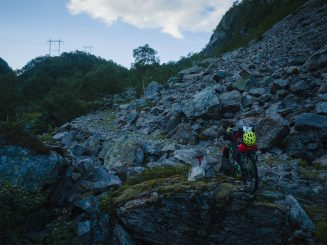 bikepacking rig and a rugged mountain track through a rocky area