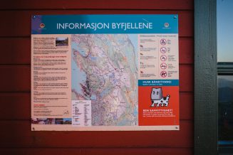 Info–map for passing hikers on a hut exterior.