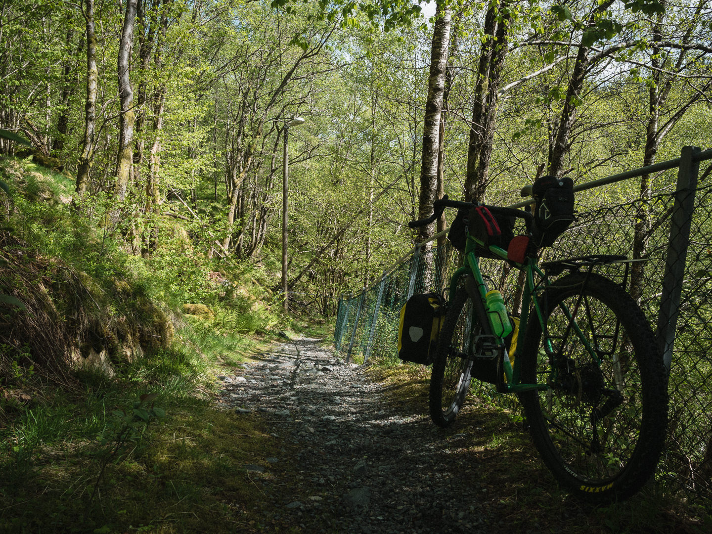 touring bicycle on a gravel singletrack