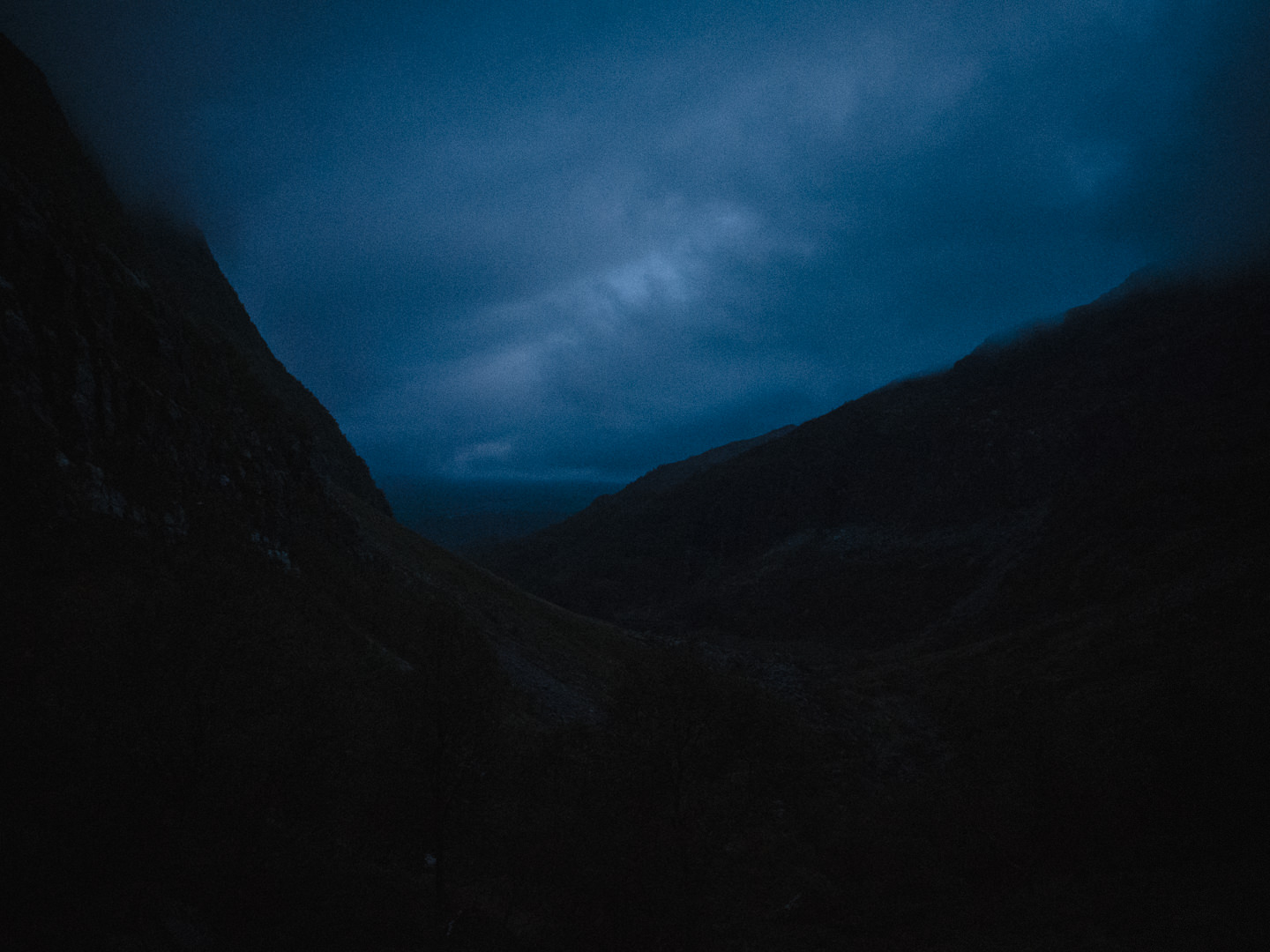 Mountain landscape, just barely visible in the dark.