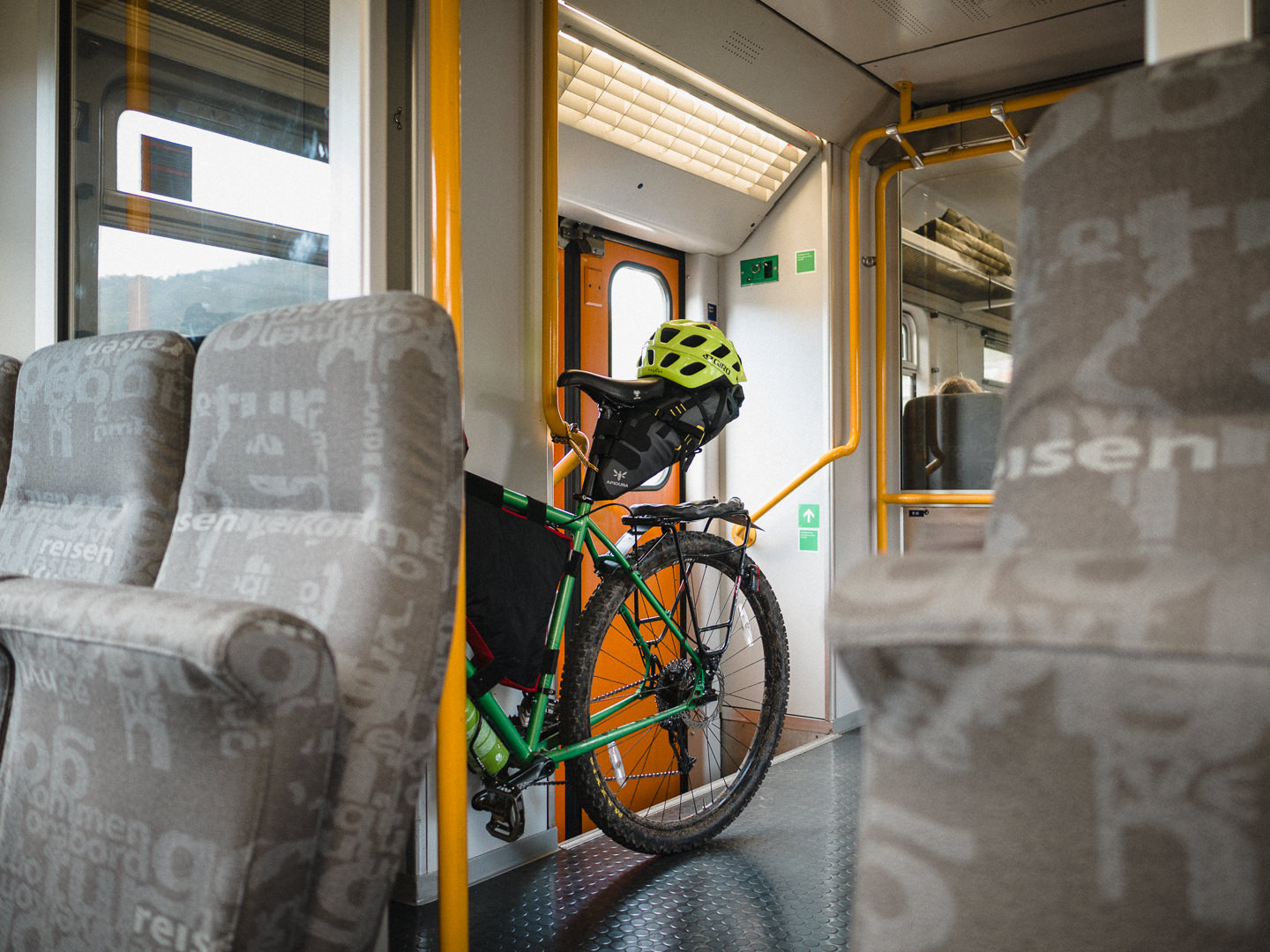 Touring bicycle on a train.